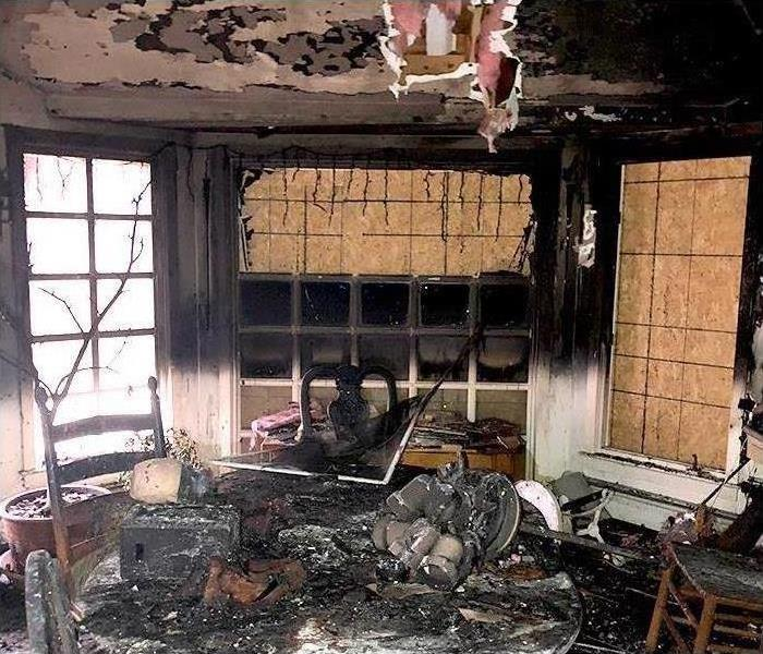 Fire damaged interior during fire damage restoration assessment and security
