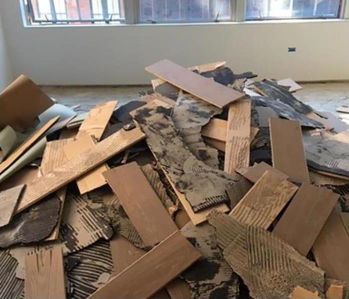 controlled demolition of damaged wood floors
