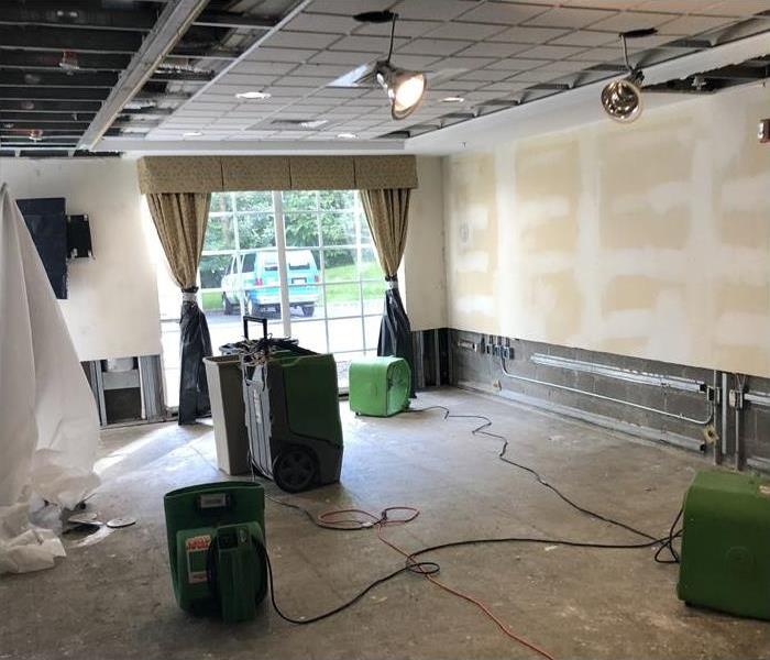 drying equipment setup during water damage restoration in conference room
